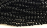 Natural Black Lava - 8mm Rounds.  Sold per 15 inch strand, apprx. 45 beads.