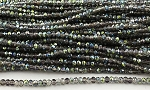 Chinese Crystal Rondelle Beads - Crystal w/ Green Iris Marea, 1.5x2mm - 1 strand